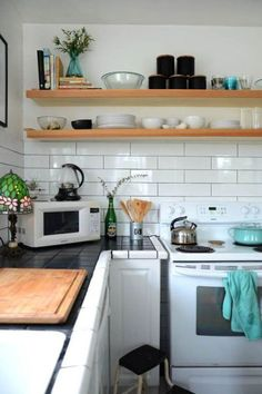 long or larger subway tile backsplash are great for a more modern and simple look in a kitchen with no upper cabinets