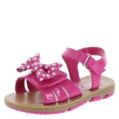 How adorable will she look in this Minnie Mouse sandal? It features a faux patent upper with hook and loop closures, darling polka dot bow on the vamp, smooth footbed, and a skid-resistant outsole. Manmade materials.