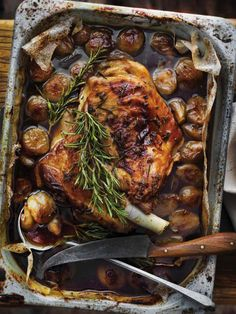 7 sprigs or rosemary 125ml extra virgin olive oil 4 garlic cloves, peeled 500g small round golden shallots 50g sugar 100ml sherry vinegar 500ml chicken stock 1.2kg boneless shoulder of lamb Coarse sea salt 6 salted anchovy fillets in oil, chopped 30g salted butter 2 x 400g cans of cooked butter beans, drained and rinsed