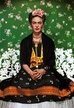 Love Frida...here she is with green wallpaper