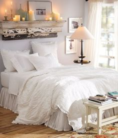 mantle above bed. all white bedding. i love all white bedding! and the mantle :) Shelf Above Bed, Ledge Shelf, Wood Shelf, Wall Ledge, Shelves In Bedroom, Master Bedroom Makeover, White Bedding, White Linens, Linen Bedding
