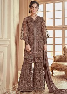 Admirable and admirable, this dark brown palazzo suit will instantly catch you admirable. Made from net, this palazzo suit is soft to touch. Featuring an admirable embroidered, this palazzo suit can be best suited for you. Muslim Fashion, Hijab Fashion, Indian Fashion, Fashion Dresses, Stylish Dresses, Icon Fashion, Frock Fashion, Ladies Fashion, Fashion Jewelry