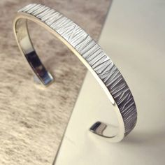I've just found Mens Silver Cuff. Each one is hand-made so the ribbed pattern varies. a wonderfully elegant mens gift. Silver Bracelets For Women, Cheap Silver Rings, Silver Ring Designs, Silver Man, 925 Silver, Sterling Silver Necklaces, Silver Earrings, Silver Bangles, Rings For Men