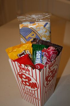 Movie Theater themed birthday party- Goody bags filled with mini popcorn bags, Airheads (bought bags from the dollar store, Tootsie pops (bunches of 8 for 1 dollar) and candy from the concession stand.