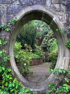 Window in a garden wall. I have always wanted a secret garden!