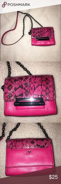 "DVF small bag with shoulder strap. Small Diane Von Furstenberg bag with black chain shoulder strap. Used 1 but no sign of wear. In excellent condition. Bag is 4 1/2 inches in height and 5 1/2 inches in length. Strap is 23"" from shoulder to top of the bag. Bag is leather - hot pink with black trim and snake skin on the front. Cute for a night out. Can hold cell phone and small wallet. No tags or duster so bag will ship as is. Diane Von Furstenberg Bags Mini Bags"
