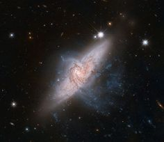 The image above looks like a classic example of a collision between two galaxies. However, Hubble scientists have determined, this is just an illusion, a trick of perspective. The two galaxies, NGC 3314A and B are actually tens of millions of light years apart instead of merging in a galactic pileup.