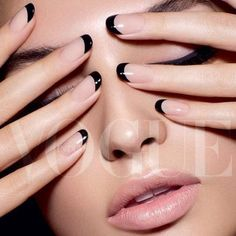 Black tips on round nude nails.