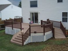 handicap ramps for homes | Deck with ramp and steps. Too busy with the railing and trellis.