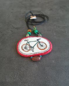 Fabric bike necklace a bicycle drawing on a textile por Percee