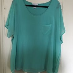 ✨NEGOTIABLE✨ turquoise short sleeve blouse Turquoise blouse with a small pocket is perfect for spring. It has 2 layers, the tank top  underneath and the sheer material on top. Tops Blouses