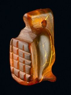 Roman Artifact found buried under London:  An amber amulet in the shape of a gladiator's helmet
