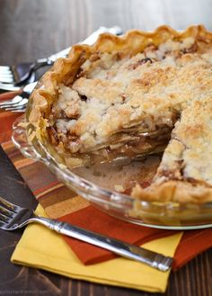 Layers of sliced apples topped with a streusel crumble make this easy Apple Pie a family favorite any time of year!