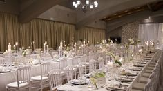 Simple white with long banquet style tables. Elegant and sophisticated