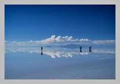 Salar de Uyuni is a magical place: When covered by water, the world's largest salt flat becomes a mirror, and anyone walking across it appears to be walking on clouds. The salt crust, which covers 4,086 square miles in southwestern Bolivia at 11,995 feet above sea level, is nearly flat, which makes it ideal for calibrating the altimeters of satellites.