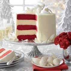 "This gorgeous, festive cake marries two favorite holiday cake flavors: red velvet and cheesecake.  The cake features layers of white chocolate cheesecake alternated with red velvet cake layers, topped with white chocolate frosting and candy ""leaves""."