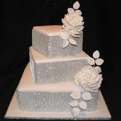 Wedding Cakes that Sparkle | Calligraphy by Jennifer lov the bling an style w blue an white orchids