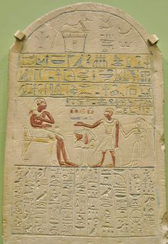 Egyptian painted limestone funerary stele of Ankhreni, steward of the granary, with his brother and sister in law. Abydos, Middle Kingdom. Now in the Ahmolean Museum, Oxford, UK