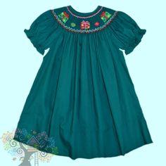 Rosalina short sleeved Bishop Dress with gifts smocked on the neck line.  Visit www.hidenseekboutique.com to order