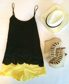 Scallops on scallops with a pop of color. Fedora hat. Wedges.