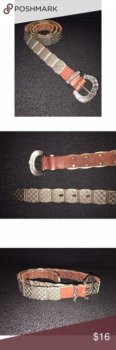 """Vintage Liz Claiborne Silver & Leather Belt Vintage (1993 stamped on inside of buckle) Liz Claiborne belt. Belt is comprised of silvertone stamped metal squares on leather. Measures 36"""" long, holes for closure at 30"""", 31"""" and 32"""". Please ask any and all questions prior to purchase. Liz Claiborne Accessories Belts"""