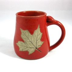 Stoneware Pottery Mug with Leaf by CrookedCreekStudio1 on Etsy  ( IDEA: ohata glaze and stain bare clay leaf)