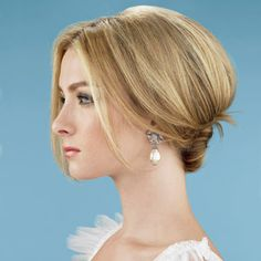 Brides.com: Wedding Hairstyle Ideas. Graceful Buns don't have to look frumpy. Here, backcombing and loose pieces at the front keep this low knot looking oh-so-chic and sexy. Earrings by Badgley Mischka, badgleymischka.com. Gown by Christos, christosbridal.com. Editor's product pick: Sally Hershberger Supreme Lift for Normal to Thin Hair
