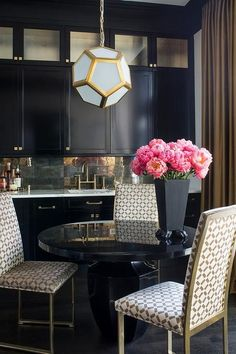 A black dining area can provide an elegant look when you add gold accents. Colorful blooms brighten up the look.