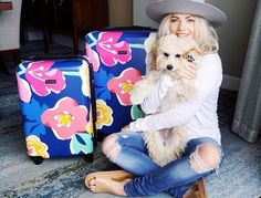 We don't know what's cuter -   @witneycarson's pup or her new luggage!