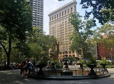 Madison Square Park and the Flat Iron Bldg. New York City