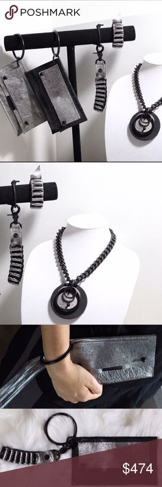 "Pewter/black handbag bundle retail $1185 1. Pewter/black leather phone clutch 8""x4.5"" black ring handle retail $325 2. Pewter/black leather phone clutch black ring handle retail $325 3. Pewter/black leather blackout necklace 20"" chain 3.5""medallion retail $175 4. Pewter/black leather D-Ring bracelet 9""adjustable retail $175 5. Pewter/black leather D-Ring keychain 6.5""X1.25"" retail $185 David Galan Bags Clutches & Wristlets"