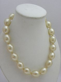 Rihanna has made Chanel pearls chic and sexy again - beautiful vintage Chanel creamy faux pearl necklace
