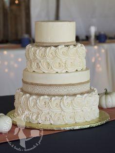 Alternating tiers of buttercream rosettes and burlap ribbon. Shabby chic, rustic, barn wedding.