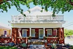 Welcoming Front Porch on a Classic Brick Craftsman