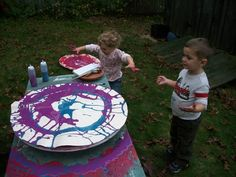 "Spin art using a bicycle wheel at 'Garden Gate Child Development Center' ("",)"