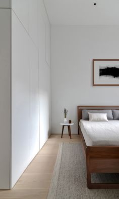 Minimal Modern Flatiron Apartment - Neutral Tones and Warm Woods Meaning 'dwell' in Japanese, this minimal modern Flatiron apartment is based in Japanese and Scandinavian sensibilities. By Echo Design Minimalist Interior, Minimalist Bedroom, Minimalist Wardrobe, Home Bedroom, Bedroom Decor, Bedroom Signs, Decorating Bedrooms, Master Bedrooms, Bedroom Apartment