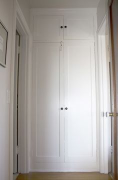 Built-in cabinets at end of a hall - idea for our garage hall next to laundry room door?