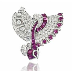 AN ART DECO RUBY AND DIAMOND DOUBLE CLIP BROOCH, BY DRAYSON   Of fan design, each pavé-set circular-cut diamond panel with baguette-cut diamond border interspersed with diamond and ruby point accents, to a central calibré-cut diamond and ruby ribbon highlight, circa 1935, 5.0cm long  Signed Drayson