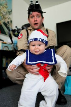 This ghostbuster looks pretty afraid of the Stay Puft Marshmallow Man. An adorable Halloween costume!