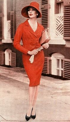 "Red suit and hat with pearls, gloves, and handbag. Cropped from an advertisement for Life Strides ""Picture Pump"" shoes in Life magazine, March 9, 1959.  1959"