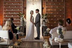 How creative! What a beautiful, yet simply elegant hand-calligraphied scroll by Laura Hopper used as a backdrop for an urban metallic wedding inspiration shoot by Sterling Social.