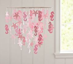 """really love this pretty paper mobile! It's an ideal inspiration piece for a sea-side or """"at the beach""""…5. Beach-side  Price: $39.00 at potterybarnkids.comI"""