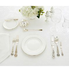 Formal Lunch    For a formal luncheon, the table is set much as for dinner with a few exceptions. The presence of an iced teaspoon and iced beverage glass announce a daytime event. The lack of candlesticks, too, is appropriate for a daylight meal.    Stemware is limited to a water goblet and a wine goblet. Old etiquette books dictated that the flatware should align at the bottom of the handle. Looser customs now allow you to arrange them in a graceful angle, if you prefer.