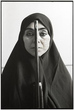 Shirin Neshat Rebellious Silence 1994 Feminist Art Neshat is an Iranian visual artist living in New York, whose work deals primarily with issues of identity and sexuality for Muslim women. Women Of Allah, Muslim Women, Shirin Neshat, Arte Peculiar, Portrait Photography, White Photography, Les Religions, Identity Art, Cultural Identity