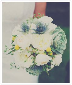 Wonderful bridal bouquet mixing florals and succulents!    Photo:  W. Scott Chester