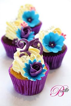 Here comes blueberry choco adult birthday cupcakes topped with vanilla and decorated with purple & blue flowers for you.Which one of those you want to taste?