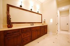 For a long vanity area, try using an extra long mirror instead of paneled mirrors.