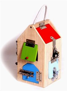 Motor activity wooden house with all different locks