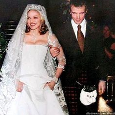 An estimated 1.5 million dollars went into the makings of madonna's marriage to Guy Ritchie in December of 2000. Among the beautiful things Madonna wore was a 1910 diamond tiara once worn by the Princess Grace of Monaco. That's a lot to spend on a wedding whose reception was held in a basement, huh? And to top it off, they divorced in January of 2009.