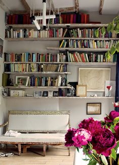 Primitive wood shelves in library-bath  ~~~     Pinned onto Spaces - Bibliothèque from vogue.com